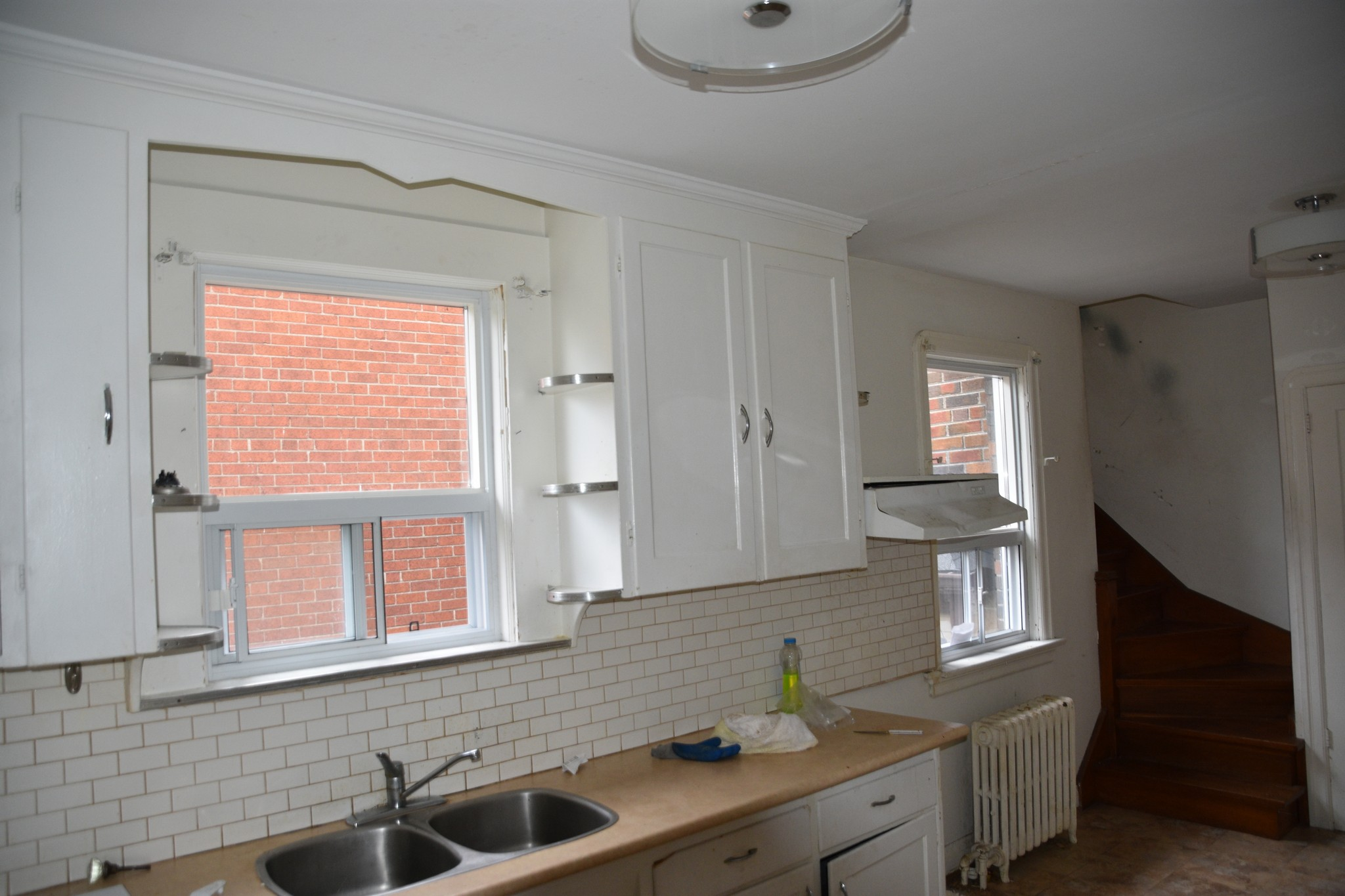 old kitchen with white cupboards